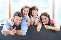 family-home-thumbs-up-happy-relaxing-sofa-54110677
